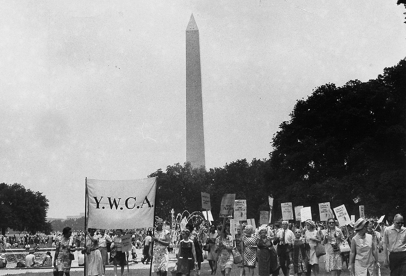 women marching in front of Washington Monument