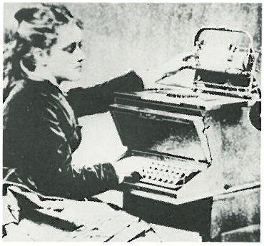 old photo of woman typing on a typewriter