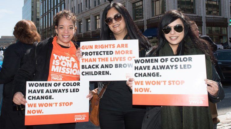 women holding up YWCA signs