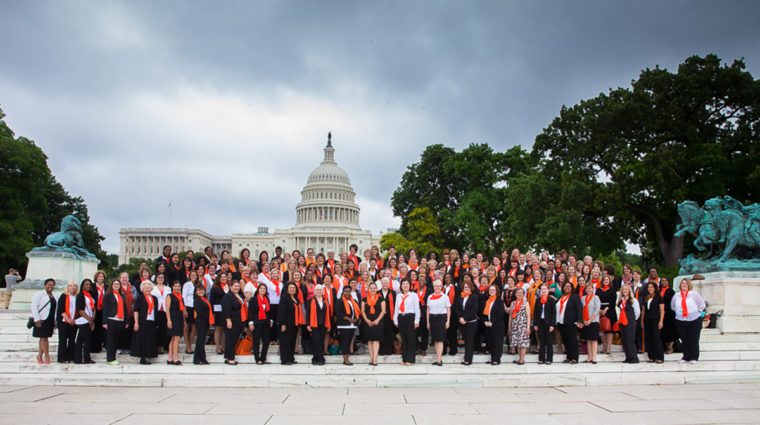 women standing in front of Capitol building