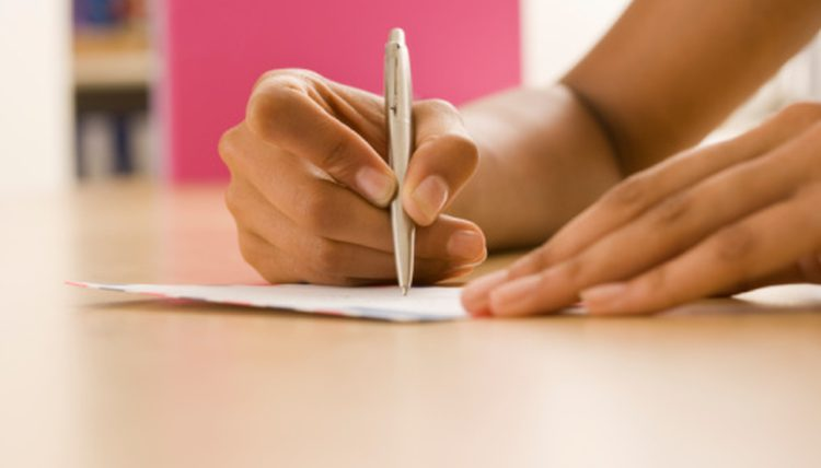 hand writing a letter